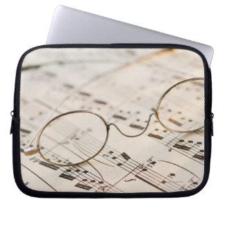 Eyeglasses on Sheet Music Computer Sleeves