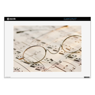 Eyeglasses on Sheet Music Skins For Laptops