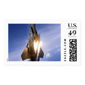 f-15 jet launching missile stamp