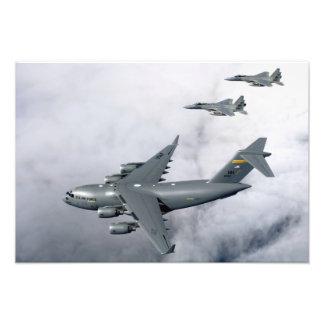 F-15B Eagles escort the first Hawaii-based C-17 Photo