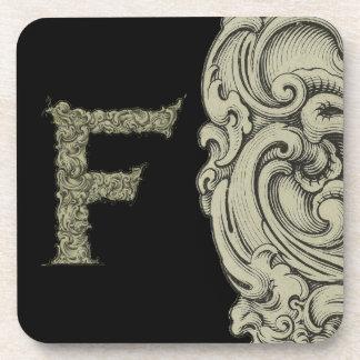F - El alfabeto de Falck (de oro) Posavaso
