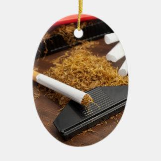 Fábrica casera del tabaco adorno navideño ovalado de cerámica