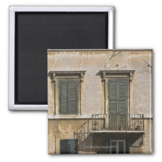 facade of building with a balcony and shuttered 2 inch square magnet