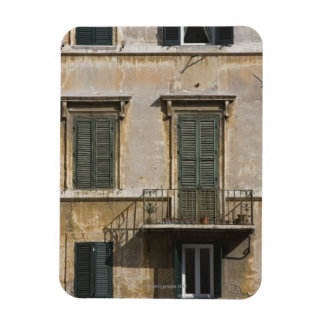 facade of building with a balcony and shuttered rectangular photo magnet