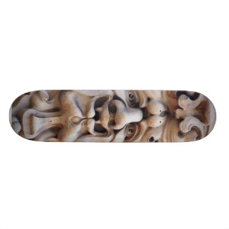 Face In Stone On Buildings Wall Skate Deck