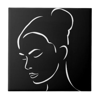 Face of a beautiful young woman ceramic tile