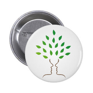 Faces forming a tree pinback button