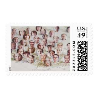 Faces over a map of America Stamp