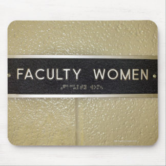 Faculty women sign mouse pads