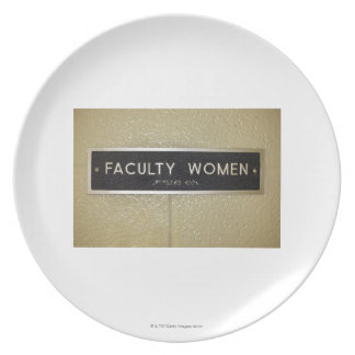Faculty women sign party plates