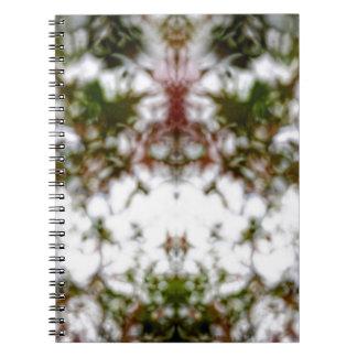 Faded kaleidoscope pattern spiral notebook