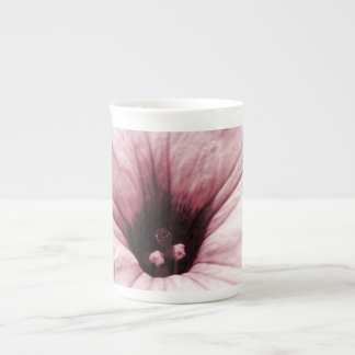 Faded purple flower macro picture tea cup