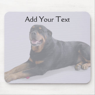 Faded Rottweiler Laying Down on Grey Mouse Pad