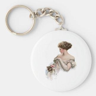 Fair Maiden Teases a Kitten Keychain