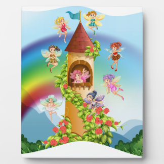 Fairies flying around the castle plaque