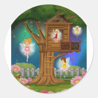 Fairies flying in the garden classic round sticker