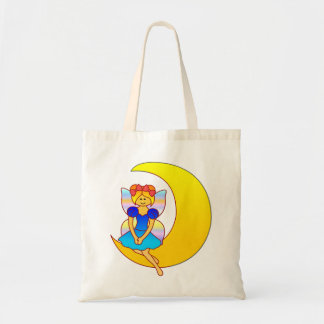 Fairy sitting on a crescent moon tote bag