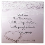 """Faith Hope Love, 1 Corinthians 13:13, Ocean Beach Ceramic Tile<br><div class=""""desc"""">Beautiful inspirational ceramic tile depicts an ocean view with a heart carved in the sand and features Bible Verse 1 Corinthians 13:13,  And now these three remain Faith,  Hope and Love,  but the greatest of these is love.</div>"""