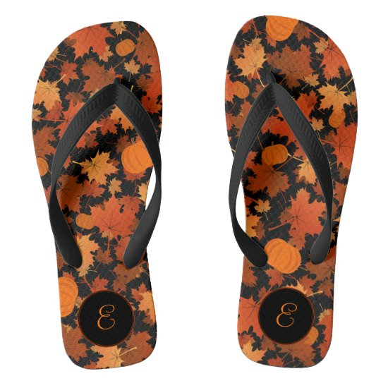 Fall colors maple leaves and pumpkins pattern flip flops