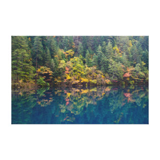 Fall colors reflected in clear blue lake canvas print