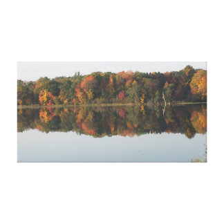 Fall colors reflections on lake in Amery Wisconsin Canvas Print