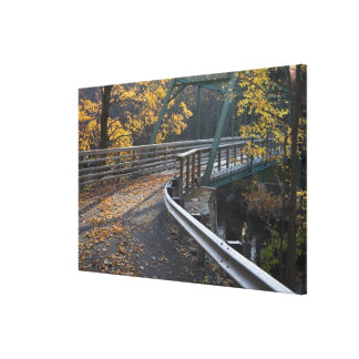 Fall foliage and a bridge over the Millers Canvas Print