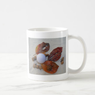 fall leaves and golf ball in sand trap coffee mug