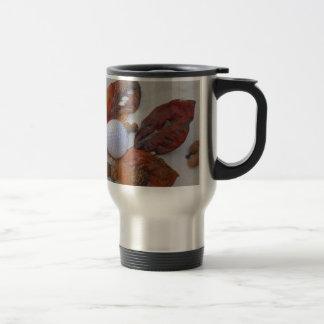 fall leaves and golf ball in sand trap coffee mug