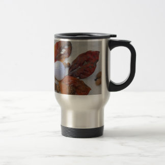 fall leaves and golf ball in sand trap travel mug