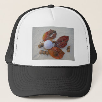 fall leaves and golf ball in sand trap trucker hat