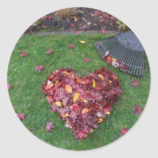 Fall Leaves Raked into Heart Shape on Green Grass Classic Round Sticker