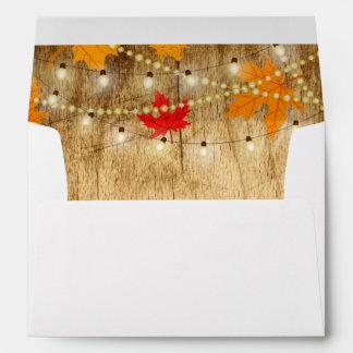 Fall wedding invite envelope wood, lights, leaves