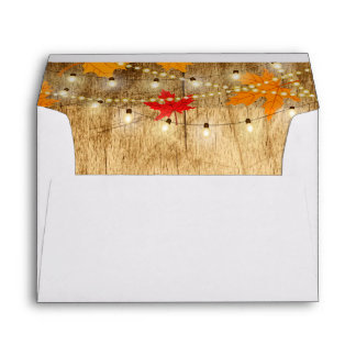 Fall wedding invite envelope wood, lights, leaves