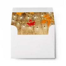 Fall wedding RSVP envelope wood, lights, leaves