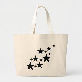 falling black stars icon large tote bag