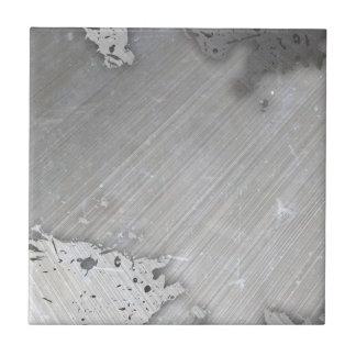 Falsa) disposición cepillada gastada del metal ( azulejo cuadrado pequeño