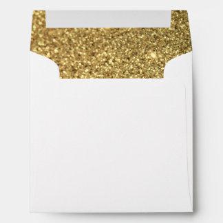 Falsa foto del brillo del oro sobres