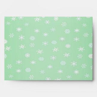 Falsa hoja del brillo del confeti verde y blanco sobres