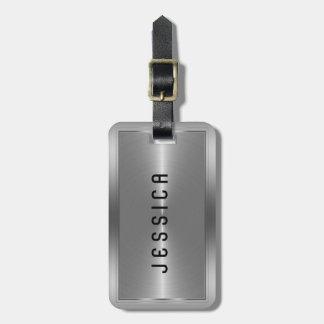 Falsa mirada de plata metálica brillante del acero etiquetas maletas