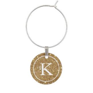 Falso brillo del oro con inicial del monograma identificadores de copas