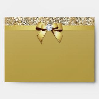 Falso diamante y arco de las lentejuelas del oro sobre