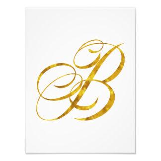 Falso diseño de letra metálico de la hoja de oro fotografías
