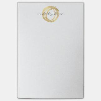 Falso logotipo pintado oro de lujo del diseñador notas post-it®