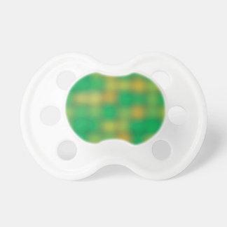 Falta de definición del verde y del color oro chupetes para bebes