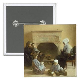 Familia asentada alrededor de un hogar pin cuadrada 5 cm