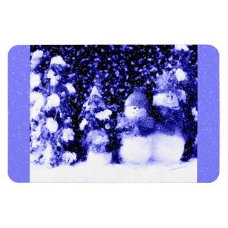 Familia azul feliz del muñeco de nieve en nieve iman rectangular