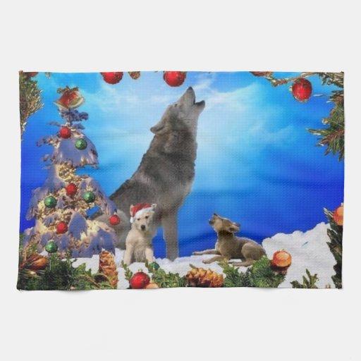 Familia cantante del lobo en la toalla de cocina