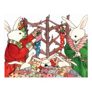 Familia del conejito del navidad tarjetas postales