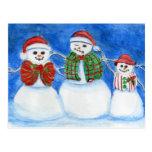 Familia del muñeco de nieve del navidad, mano postal