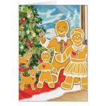 Familia del pan de jengibre con su árbol de tarjeta de felicitación